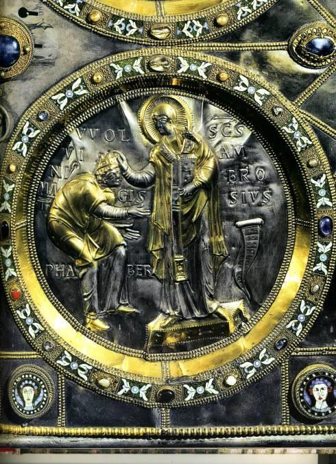 """Vuolvinio / Vuolvinius Magister Faber (Attivo a Milano, IX secolo / Active in Milan, Eleventh Century), """"L'autore inginocchiato davanti a Sant'Ambrogio"""" / """"The Artist kneeling in front of St Ambrogio"""", da / from: """"Altare d'oro di Sant'Ambrogio"""" / """"St Ambrogio Golden Altar"""", ca. 835, Formella in rilievo realizzata in lamine d'argento dorato / Sheet of embonded gilded silver with gens and enamels, Sant'Ambrogio, Milano"""