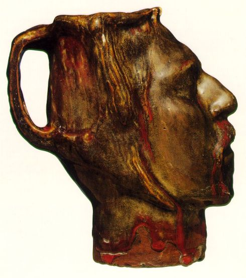 "Paul Gauguin (1848, Paris - 1903, Hiva Oa), ""Brocca a forma di testa, Autoritratto"" / ""Jug in the Form of a Head, Self-portrait"", 1889, Porcellana dura vetrificata in verde oliva, grigio e rosso / Stoneware glazed in olive green, gray and red, Altezza / Height 19.3 cm, Museum of Decorative Art, Copenhagen"